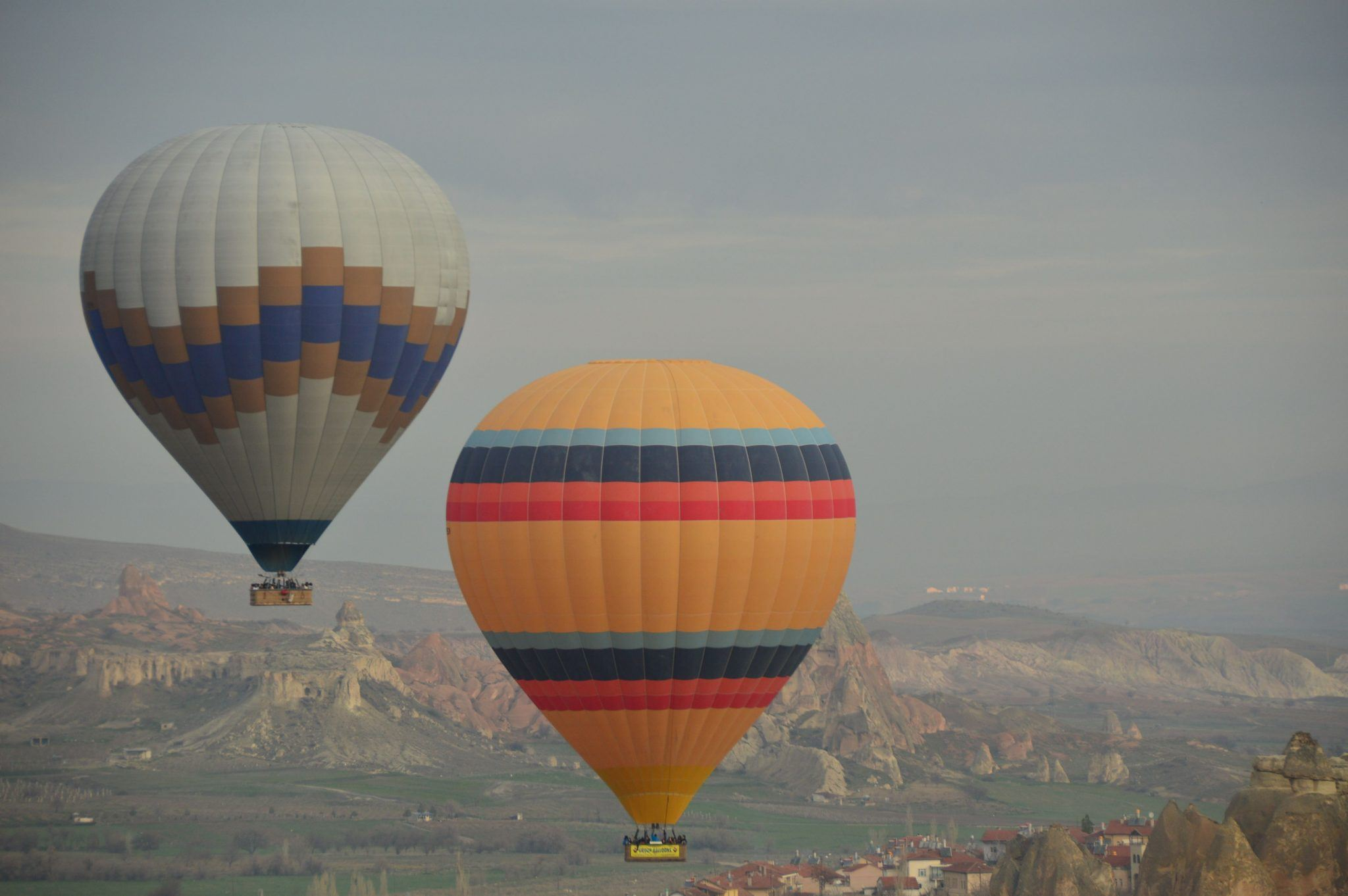 full yellow and blue balloons against Cappadocia