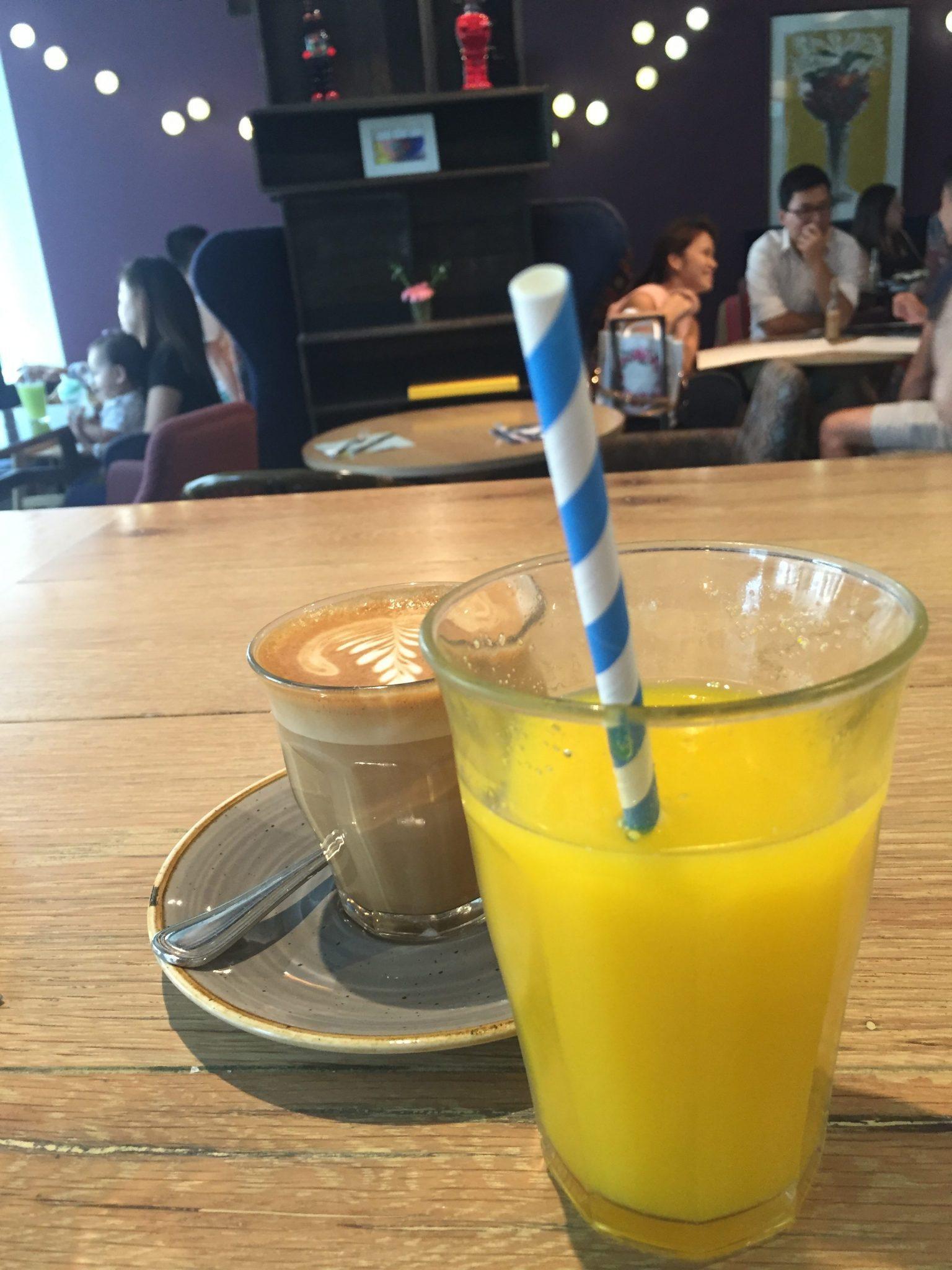 orange juice and a flat white at wild honey singapore