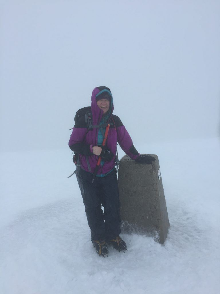 person at ben nevis summit in white out