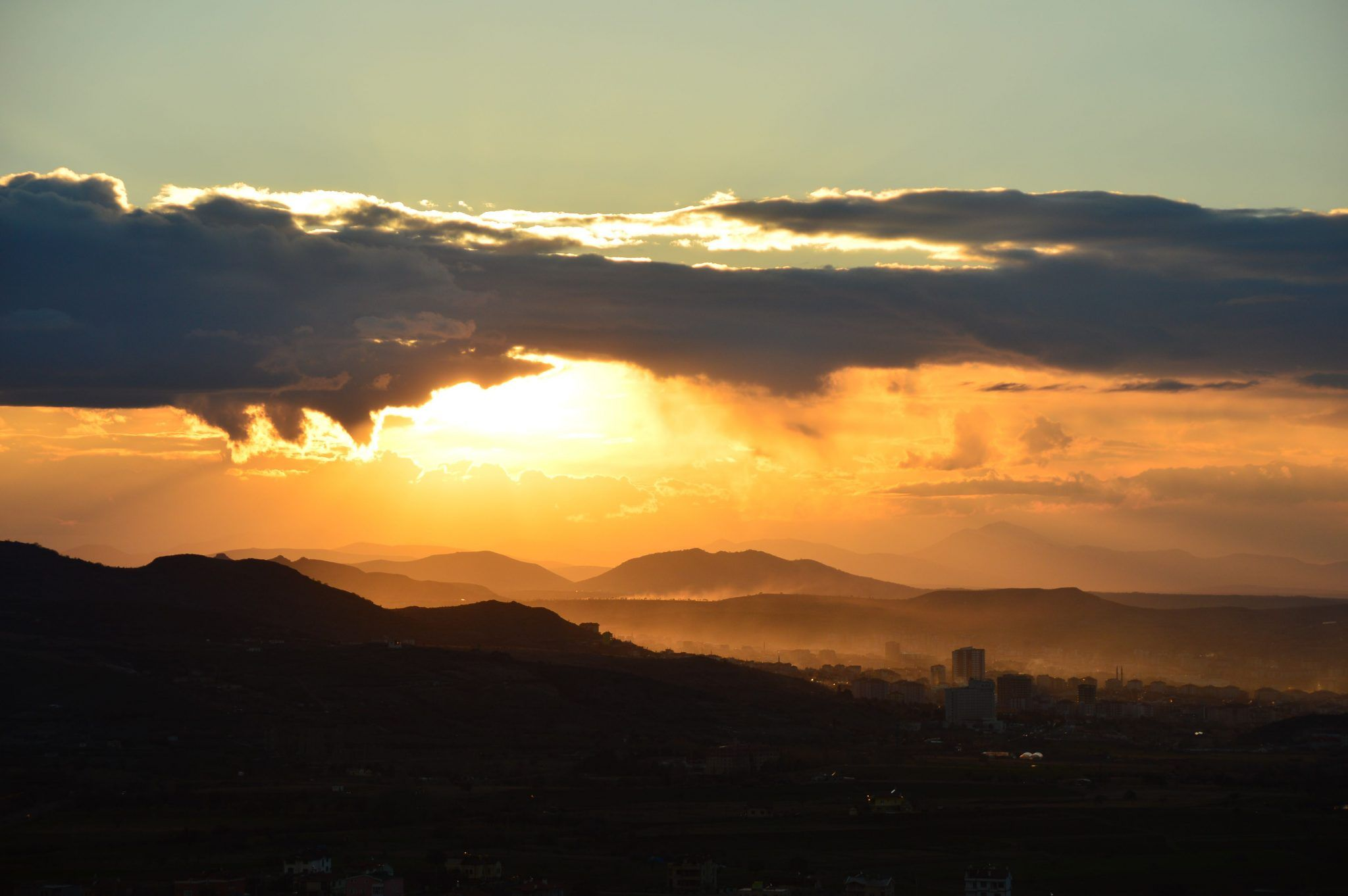 view of the sunset over cappadocia from Uchisar castle