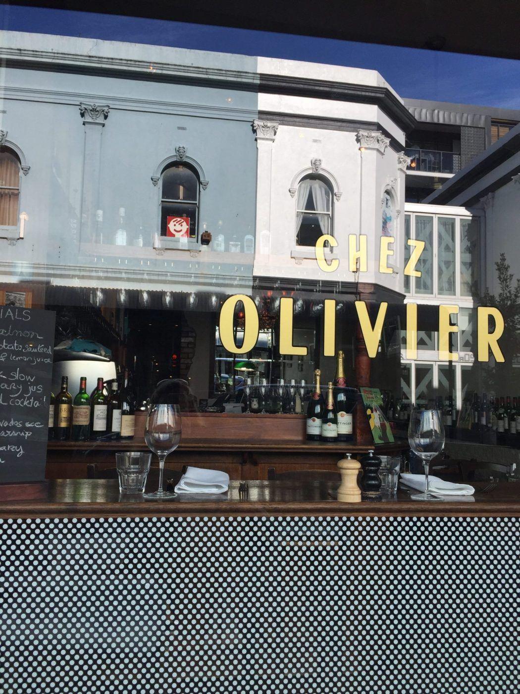 front window of Chez Olivier restaurant