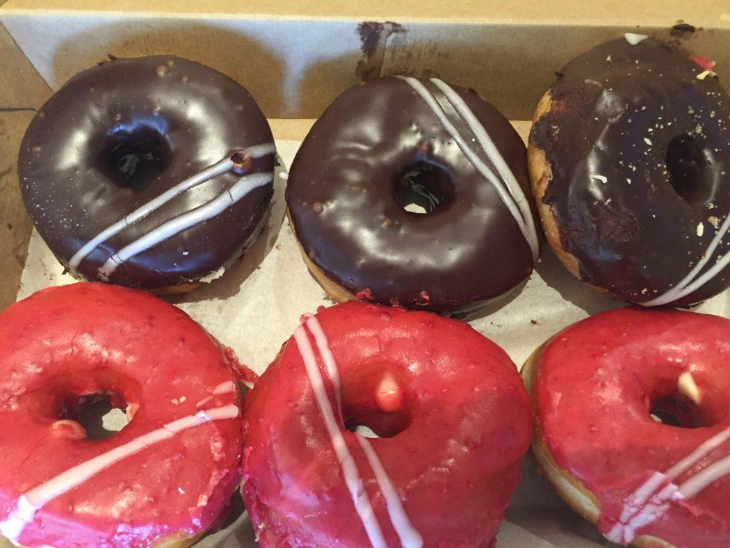donuts with pink and chocolate icing