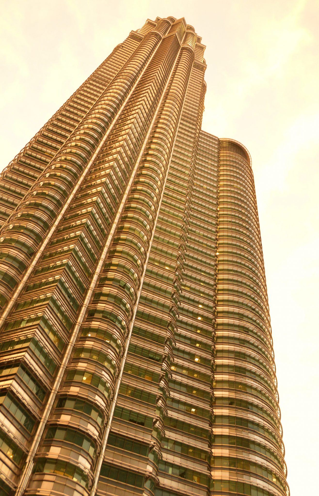 a petronas tower from the ground looking up