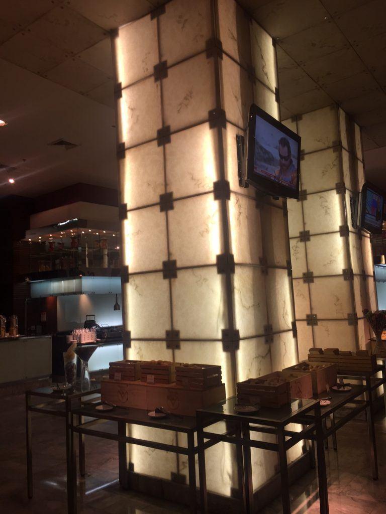 lit up pillar with tv and cutlery breakfast buffet area novotel near bangkok airport