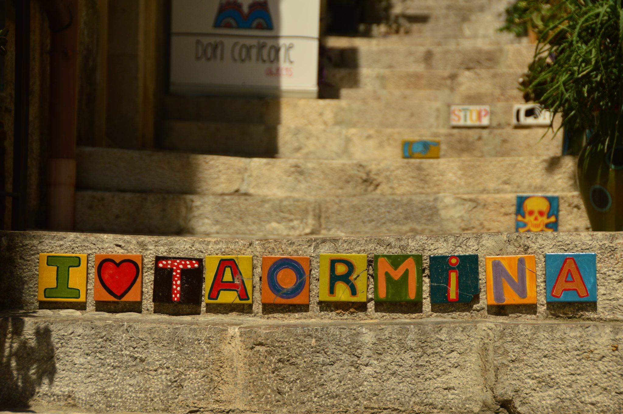tiles spelling out I love taormina on steps