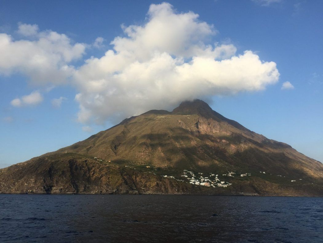 Aoelian island seen from the sea with cloud above