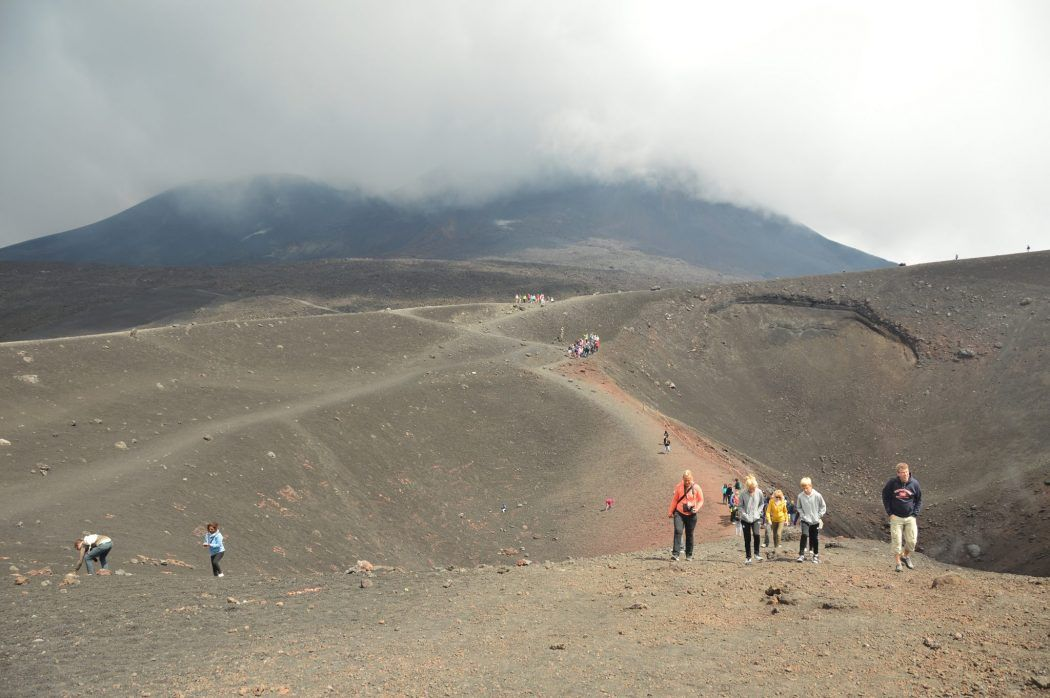 people walking on the top of Mount Etna sicily