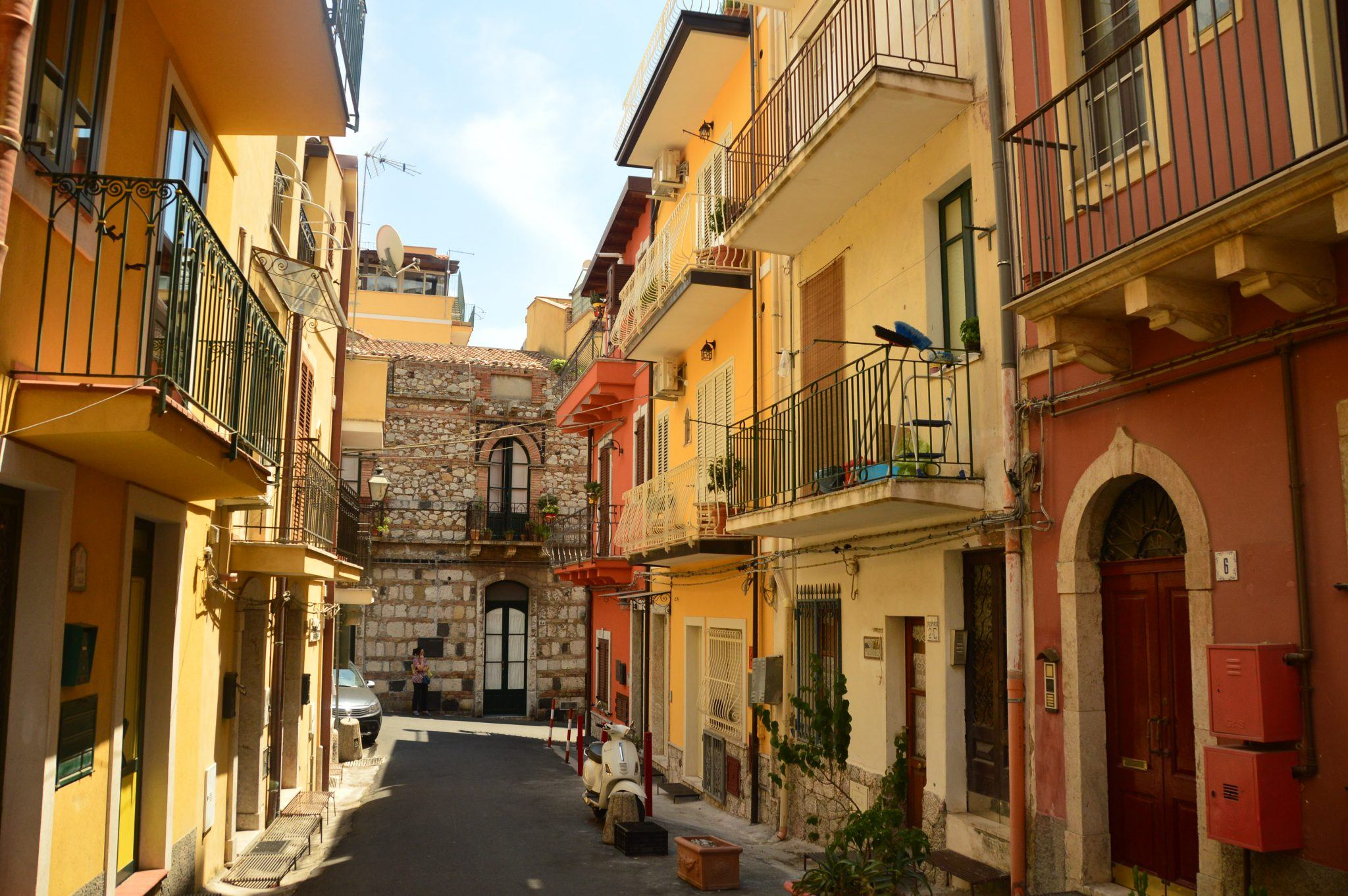 taormina back street with yellow and orange houses