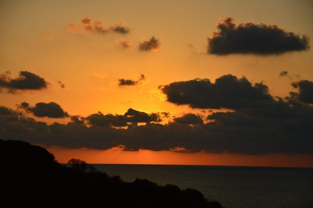 orange sunset sky seen from salina aeolian island sicily