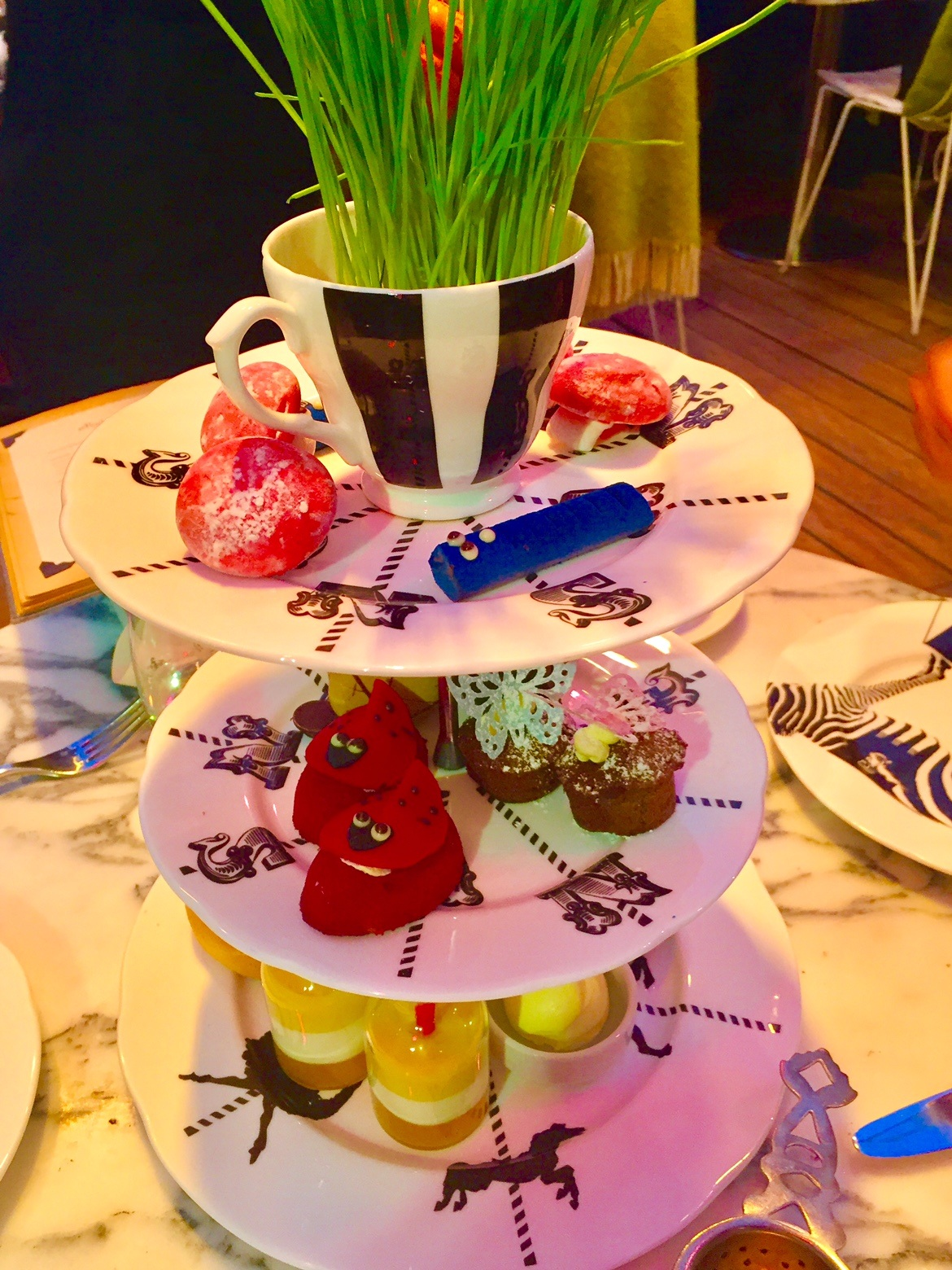 3 tiered plates with sweet selection at the mad hatter's afternoon tea