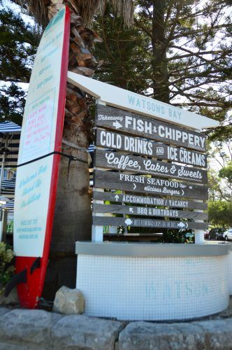 multiple signs with food and drinks at watsons bay sydney