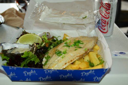 barramundi oysters and chips in a box with a diet coke doyles watsons bay sydney