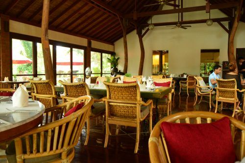 empty teak looking restaurant during the day