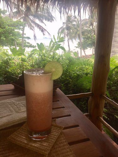 tropical strawberry drink on an outside exotic table