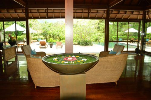 room with large pool of water and chairs and pool outdoor area at The Farm Phillipines