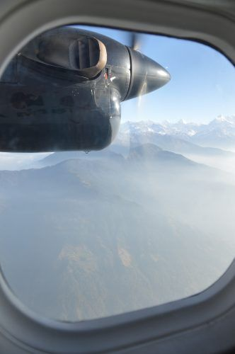 propellor outside plane window over the himalayas