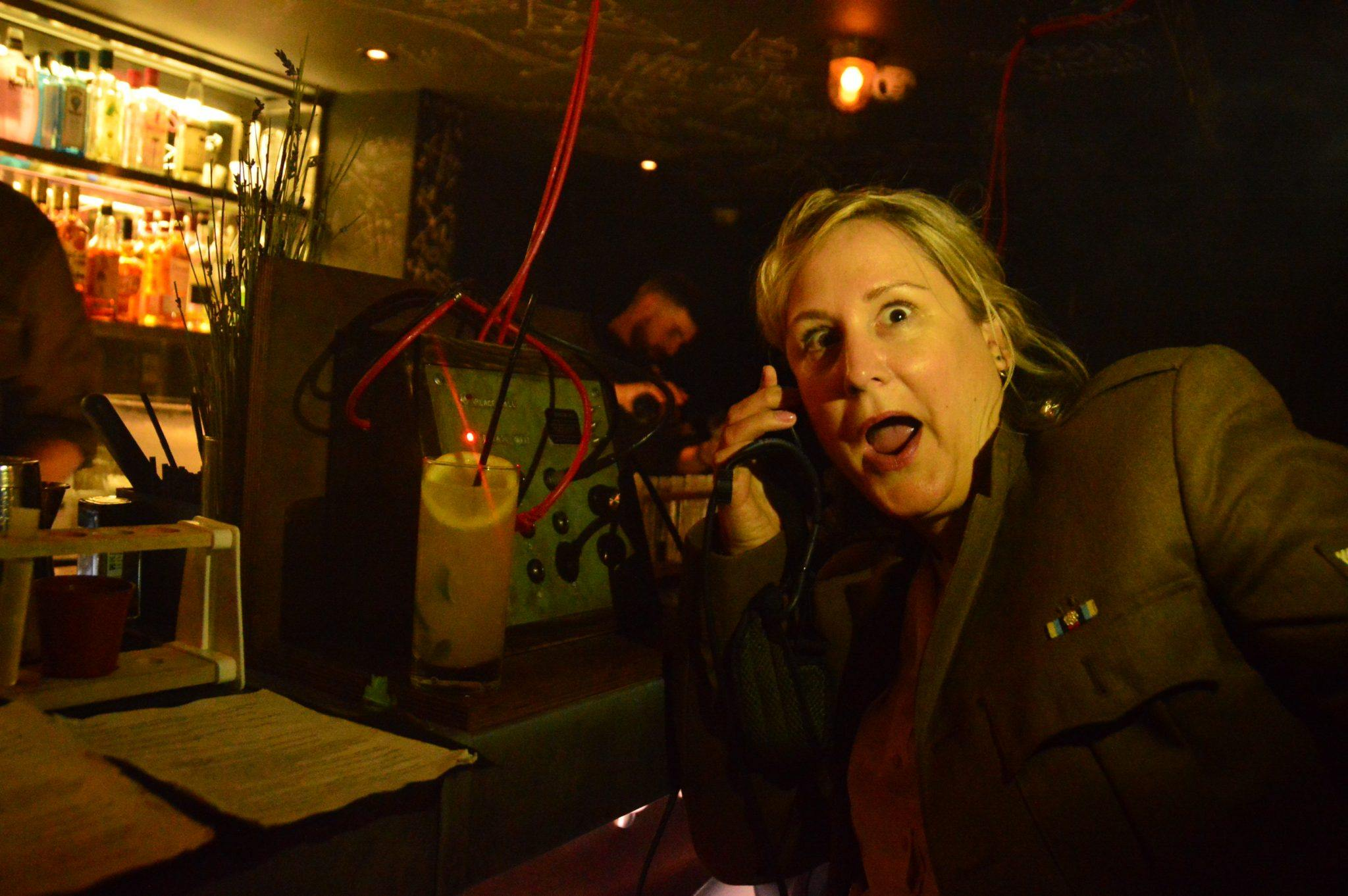 woman in the bletchley bar on an old fashioned phone