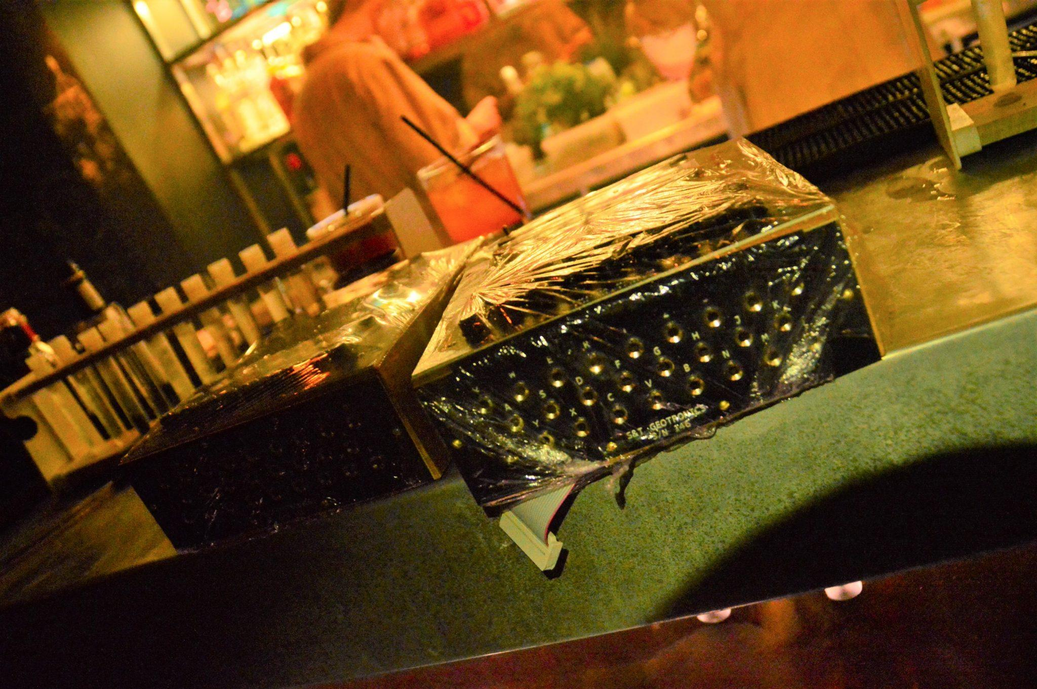 enigma machine on a bar at the bletchley bar