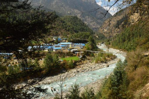 river and houses heading into phakding nepal