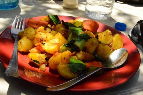plate of potatoes with greens from the everest base camp trek