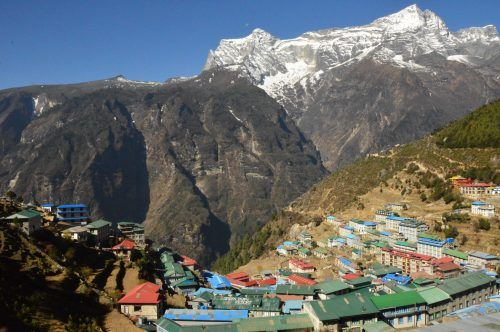 the town of namche bazaar with mountains in the background