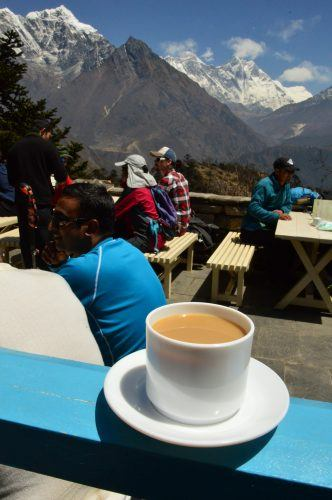 cup of coffee on terrace with mount everest behind