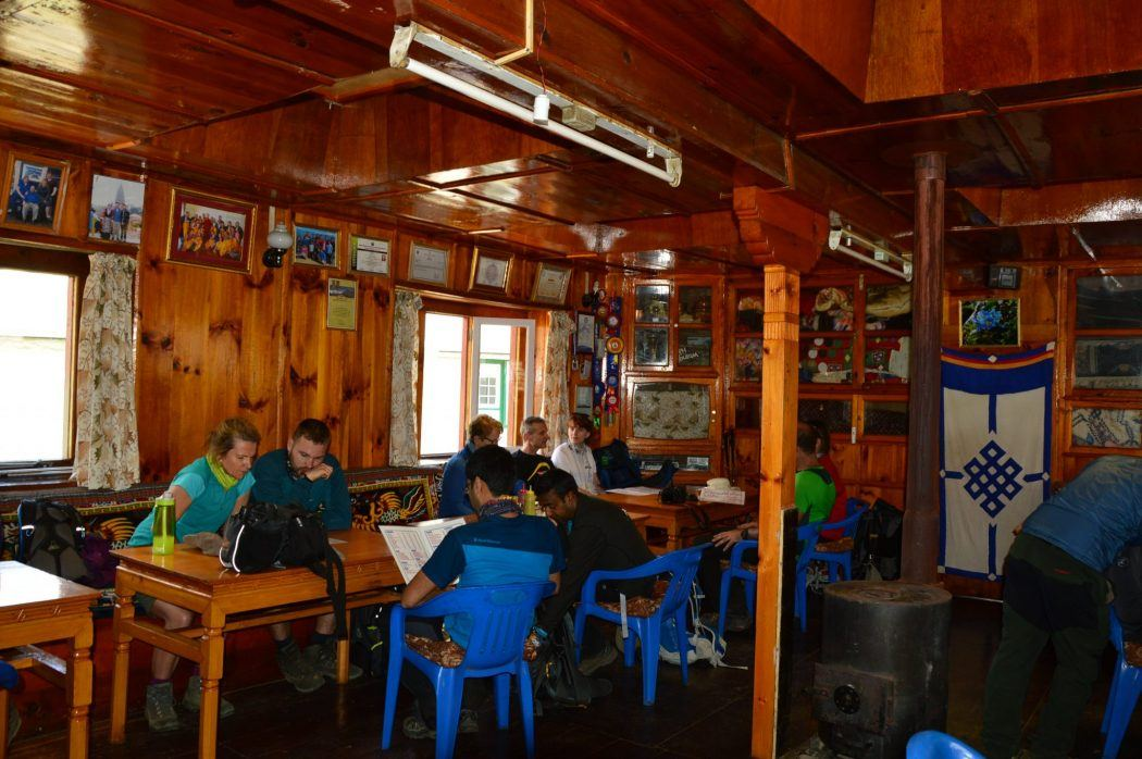 communal area on the everest base camp trek with people at a table