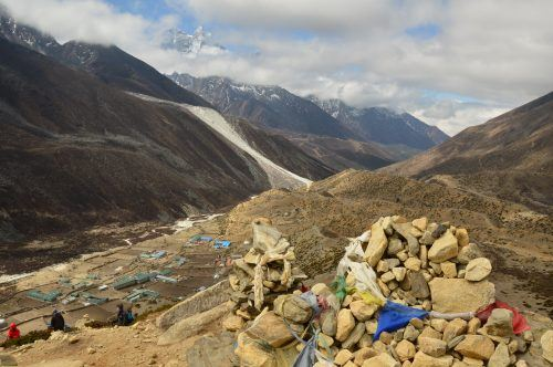 mountain path with rocks and mountains in background everest base camp trek