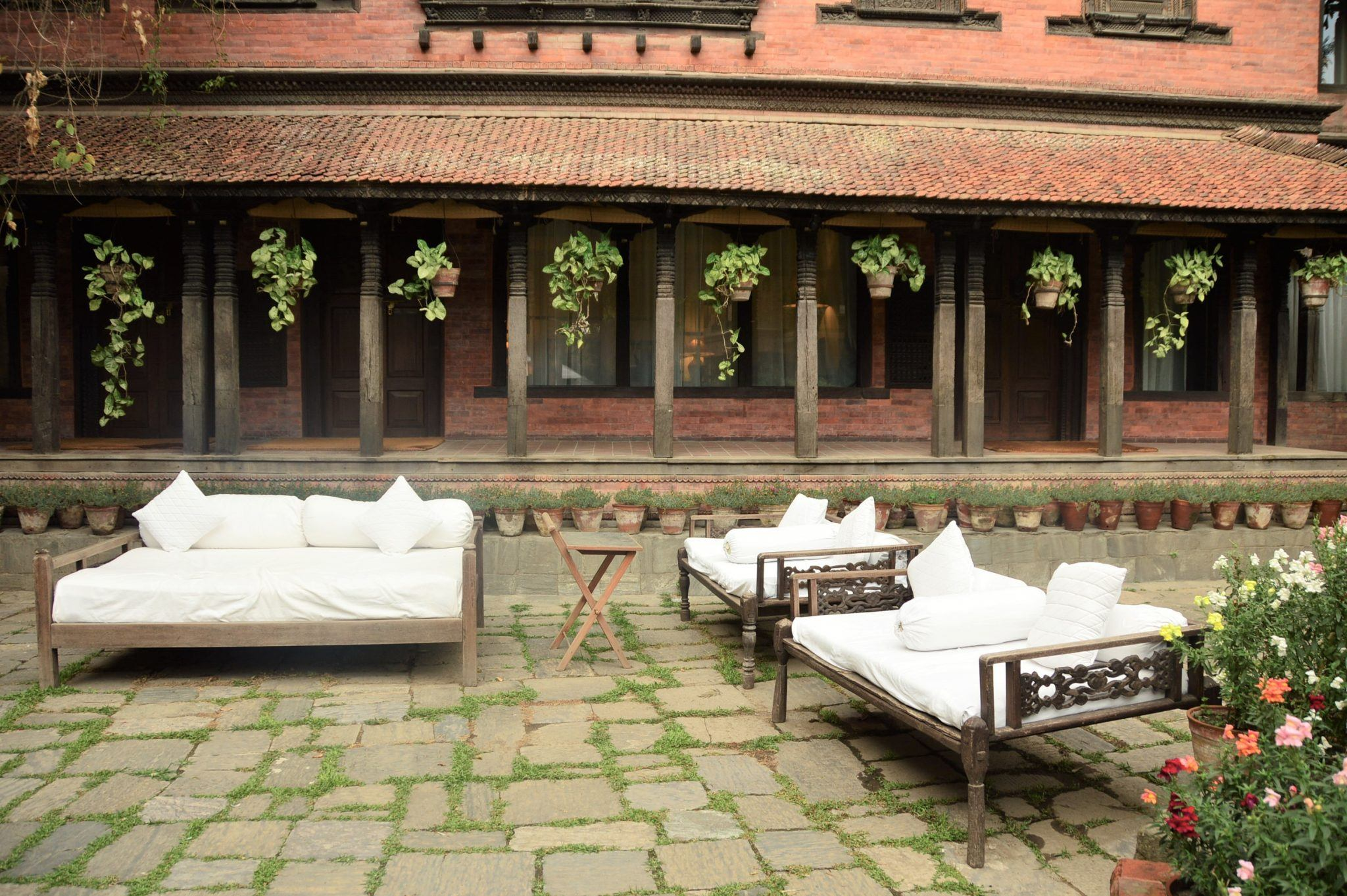 dwarika's hotel, kathmandu courtyard area with day beds