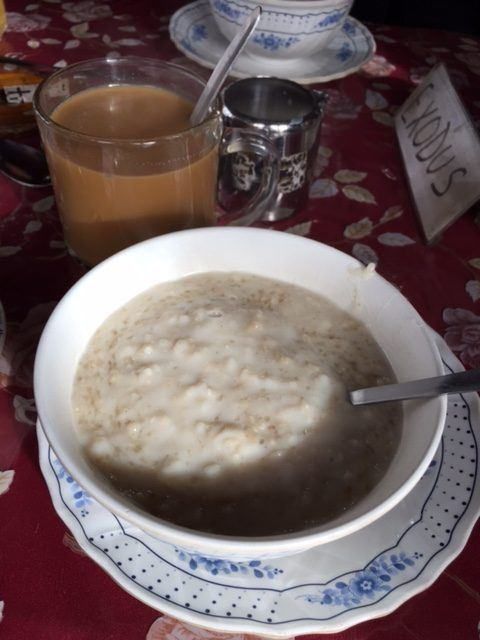 bowl of porridge and coffee at a nepal tea house