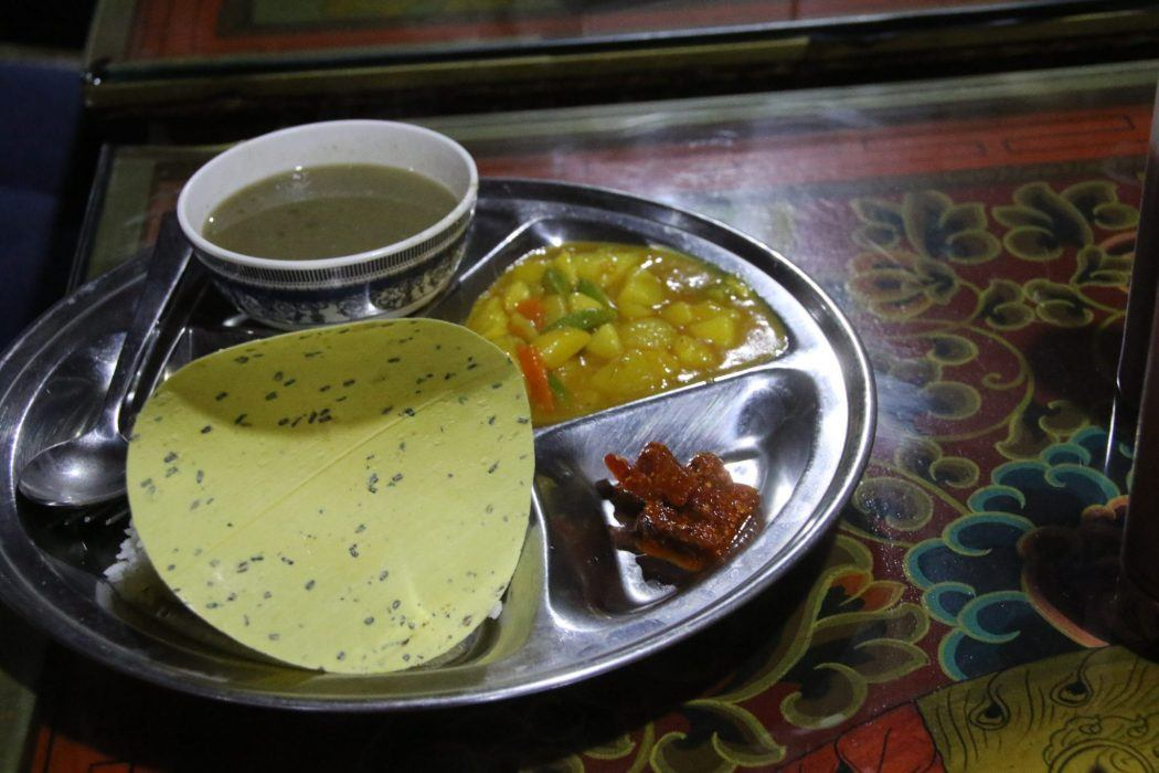 dal bhat on a silver tray