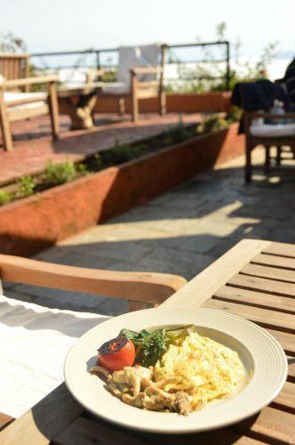 scrambled eggs on a plate outside dwarika's resort dhulikhel