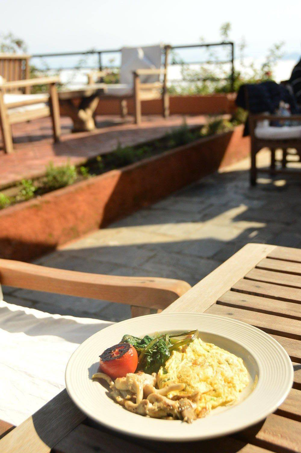 scrambled eggs on a plate outside dwarika's resort dhulikhel