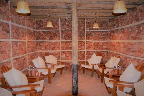 pink himalayan salt room with chairs at dwarika's resort dhulikhel