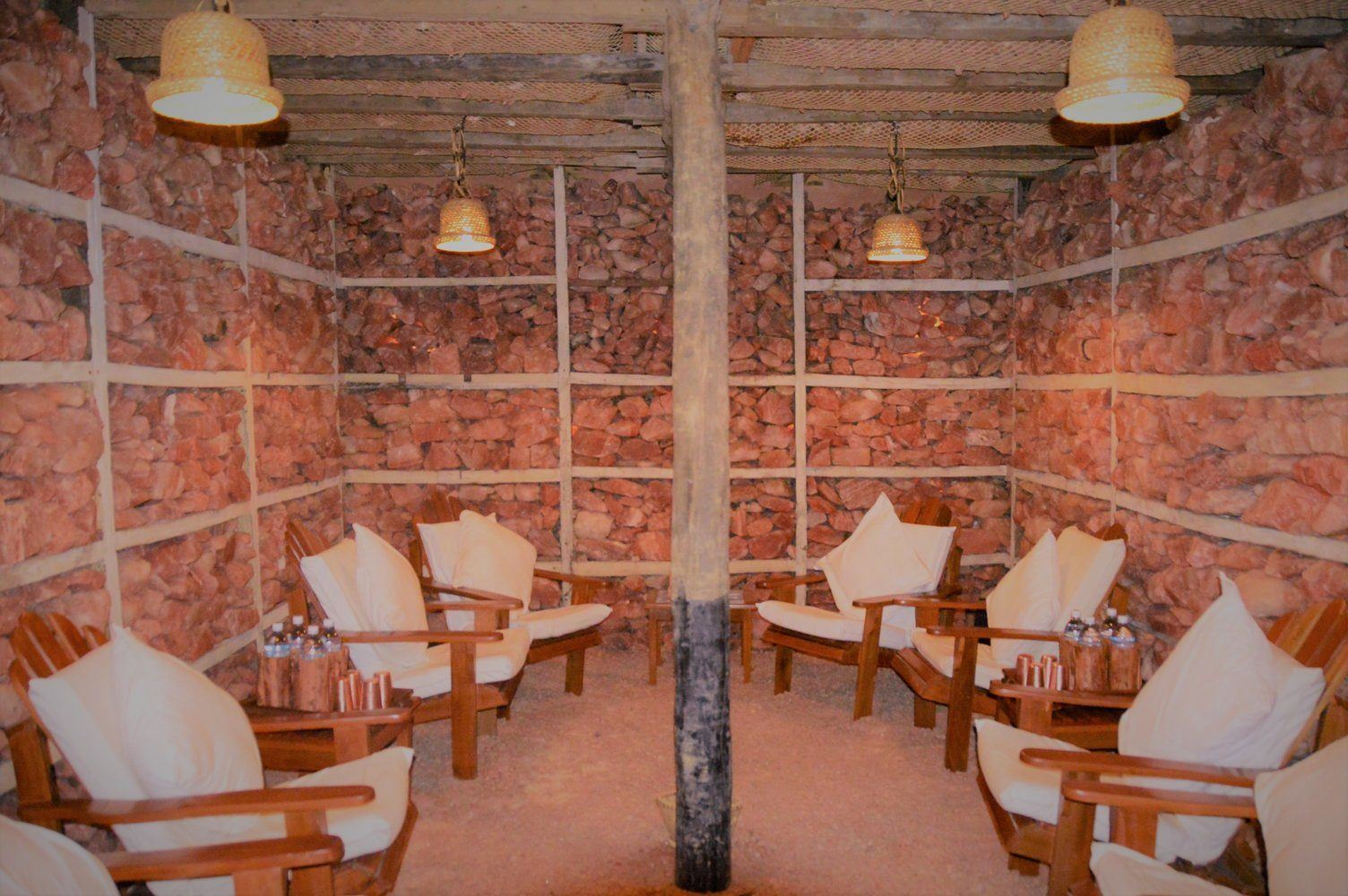 pink himalayan salt room with chairs at dwarika's resort dhulikhel
