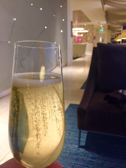glass of champagne in the qatar airways business class lounge heathrow