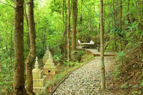 outdoor path through garden at dwarika's resort dhulikhel
