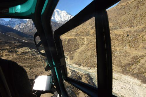 view of the himalayas from a helicopter flying to lukla