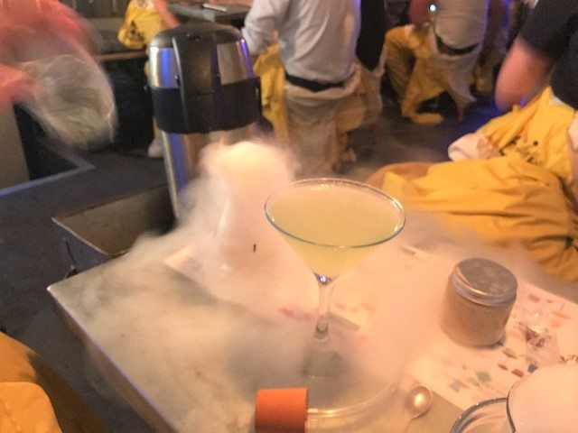 dry ice machine next to a cocktail