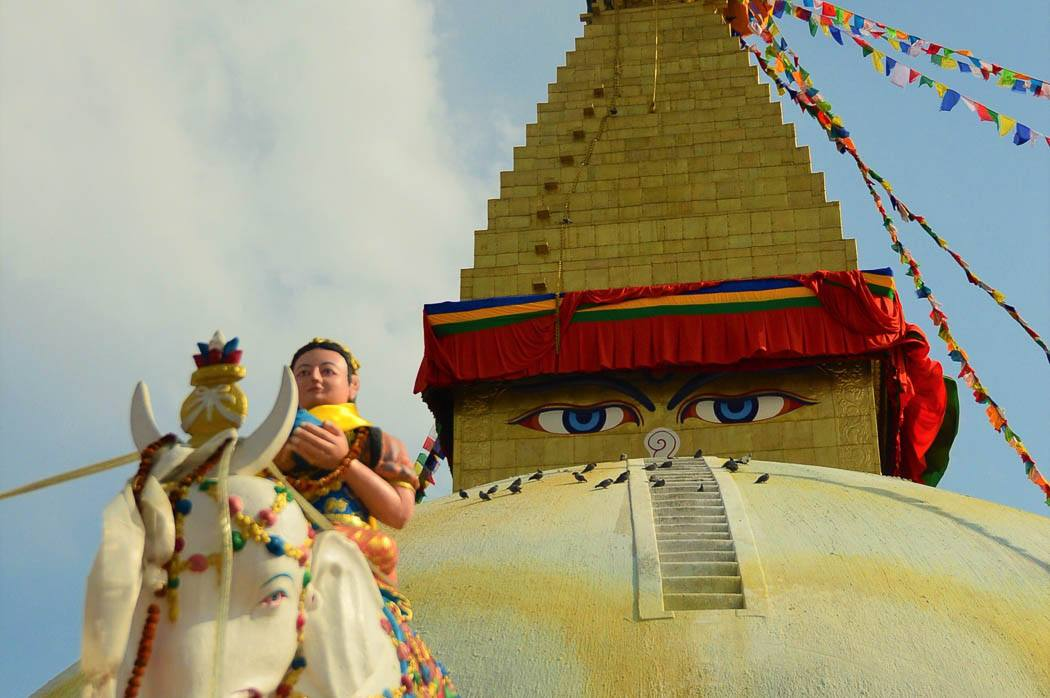 small figure in front of the eye of boudhanath stupa kathmandu