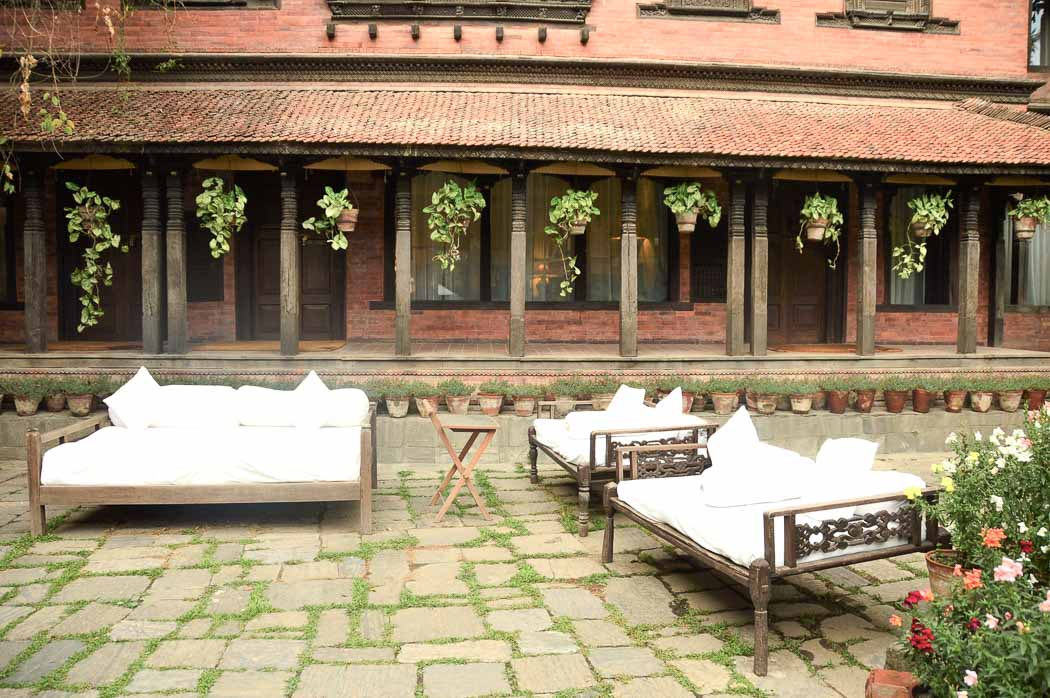 outdoor couches in the courtyard at dwarika's kathmandu