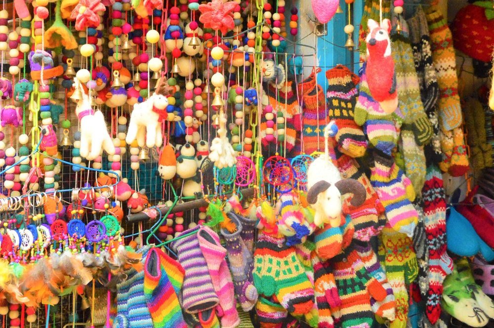 colourful necklaces and socks on display in a kathmandu shop