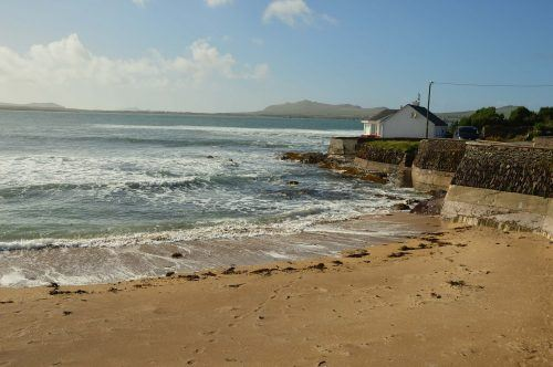 building on beach and seafront dingle peninsula ireland