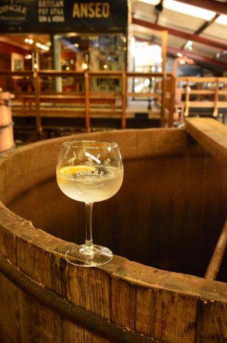 glass of gin and tonic inside the dingle distillery ireland