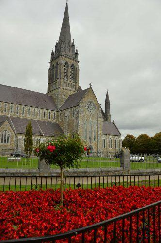 killarney church with red flowers in killarney ireland