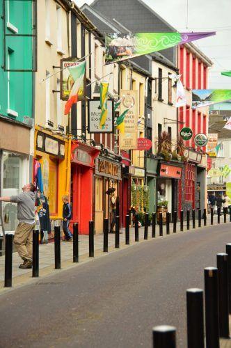 colourful houses on main street killarney ireland