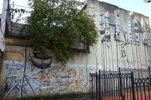 street art working with tree growing east london