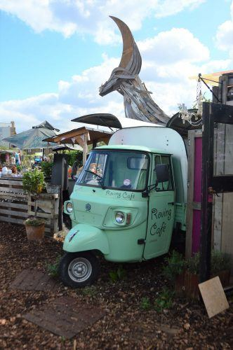 truck front with coffee shop inside in garden east london