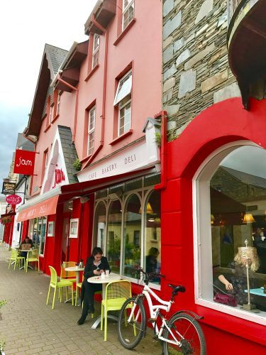 red buildings and outdoor seats on a street in killarney ireland