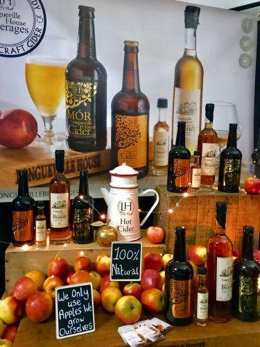 bottles of apple cider and apples